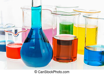 volumetric flask and beakers with different types of indicators in acids and basis