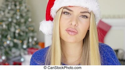 Beautiful young woman in Santa Claus hat - Adorable blond...