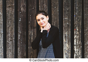 Outdoor fashion portrait of young 20 year old girl wearing...