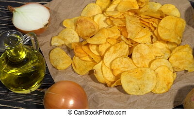 Onion potato chips dolly with oil, potato and onion.