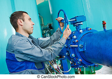 serviceman operating industrial water purification or...
