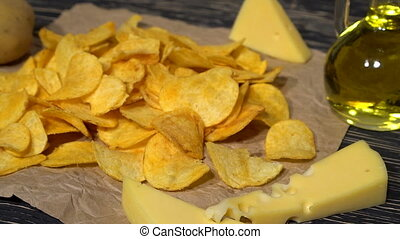 Cheese potato chips dolly with oil, potato and cheese.