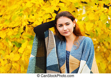 Autumn portrait of young and beautiful mixed race Asian Caucasian woman