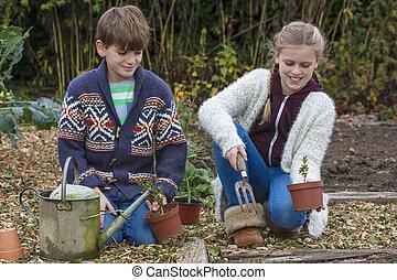 Boy and Girl Children Gardening