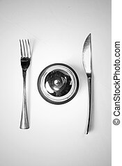 fork and knife on table with restaurant ring