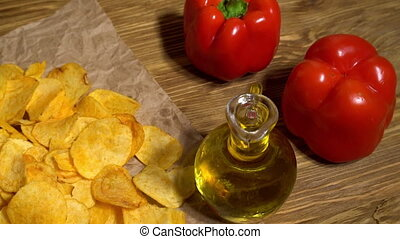 Paprika potato chips dolly with oil, potato and paprika.