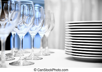 glass goblets and plates on the table