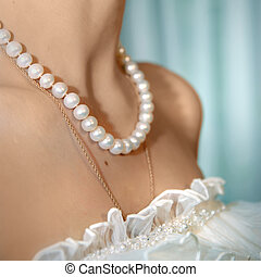 wedding photo of pearl on the neck