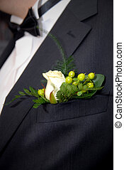 wedding buttonhole with rose on mans suite