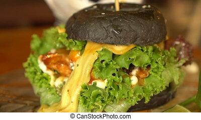 Closeup of home made black burger - Closeup of beautifully...