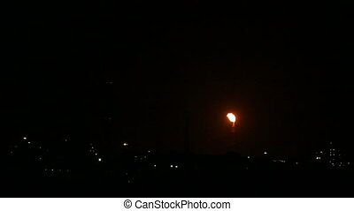 view on petrochemical factory with flame at night