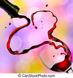 Heart from pouring red wine in goblet on color background