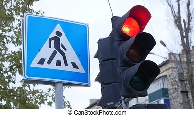 traffic signal changes from red to green sign next to a pedestrian crossing