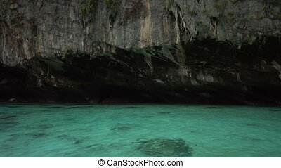 Viking cave shot from boat - Viking cave and clear blue sea...