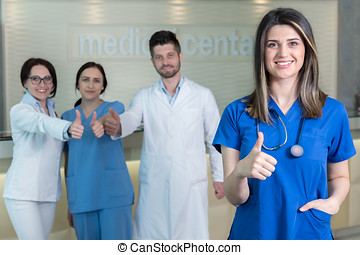 Attractive female doctor in front of medical group . -...