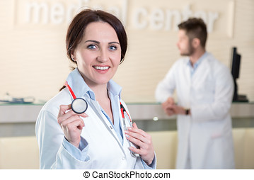 Woman doctor holding a stethoscope in medical center