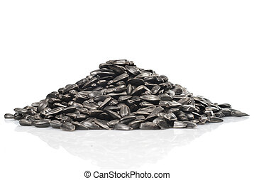 pile of black sunflower seeds isolated on a white background