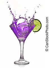 Violet alcohol cocktail with splash and green lime isolated on white