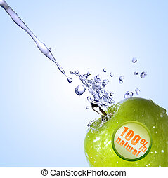 fresh water splash on green apple