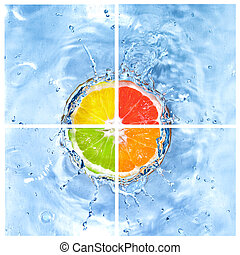 mix of citrus dropped into water with bubbles isolated on...