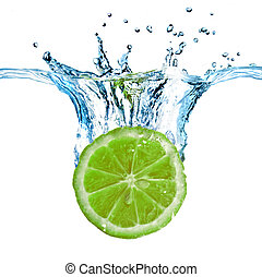 Fresh lime dropped into water with splash isolated on white