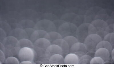 Bokeh background of water drops on a gray background. Water...
