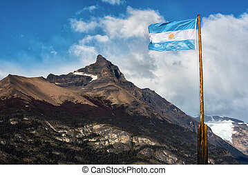 Argentine flag flying in front of the mountain