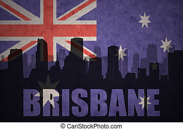 abstract silhouette of the city with text Brisbane at the vintage australian flag