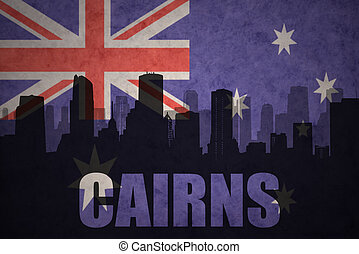 abstract silhouette of the city with text Cairns at the vintage australian flag