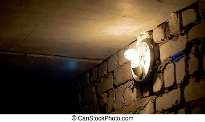 Filament Bulb Lights Off on a Stone Wall