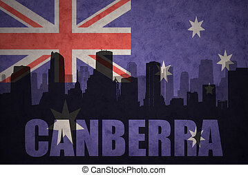 abstract silhouette of the city with text Canberra at the vintage australian flag