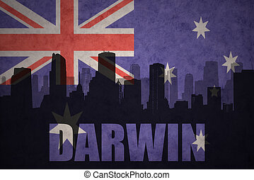 abstract silhouette of the city with text Darwin at the vintage australian flag