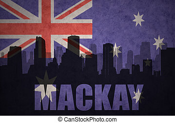 abstract silhouette of the city with text Mackay at the vintage australian flag