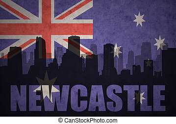 abstract silhouette of the city with text Newcastle at the vintage australian flag