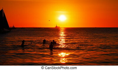 Sailboats at sunset time - Sailboats cruising at dusk, very...