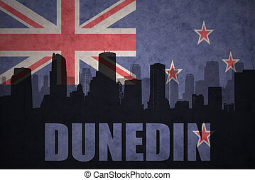 abstract silhouette of the city with text Dunedin at the...