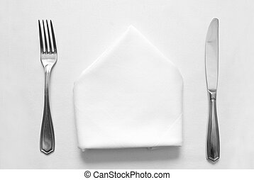 knife, fork and napkin in restaurant