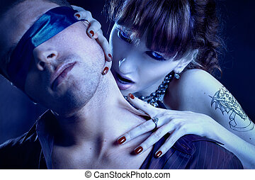 woman vampire bites a blindfolded man