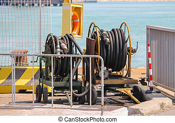 Dock equipment at the berth in Piombino seaport, Italy