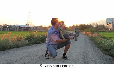 Father and son playing on the road