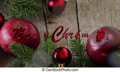 Merry Christmas - Apples, fir and red Christmas baubles with...