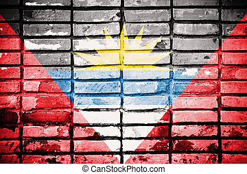 Antigua and Barbuda flag on old brick wall