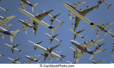 Multiple modern airliners flying high above. Travel, flight,...