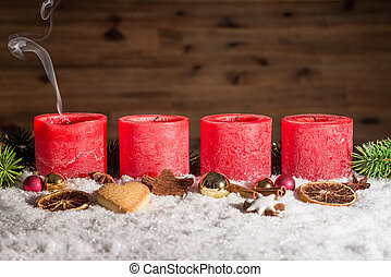 Four blown out advent candles with space - Four red blown...