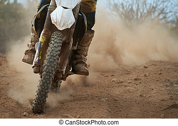 Motocross racer accelerating speed in track,driving in the...