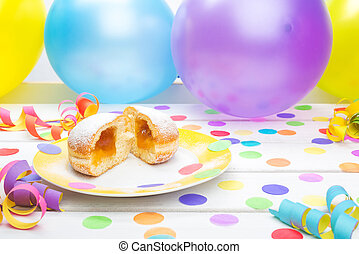 Pancake with confetti, streamers and balloons