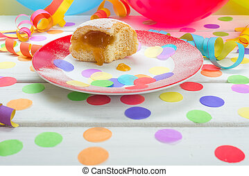 Berliner pancake with confetti, streamers and balloons