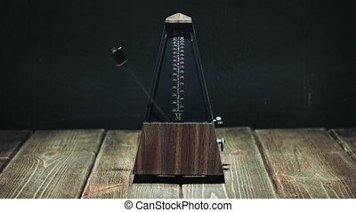 Vintage metronome beats the rhythm - Vintage metronome with...