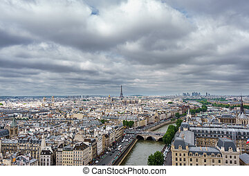 Eiffel tower over Paris, cloudy day - Cloudy day and Eiffel...