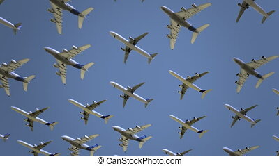 Airliners passing by against blue sky. Vacation, tourism,...
